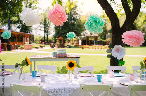 Obraz A table set for kids birthday party outdoors in garden in summer. - fototapety do salonu