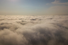 Aerial View Over White Clouds ...