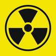 Yellow and black Radioactive radiation warning icon symbol shape. Atomic energy nuclear dangerous caution logo sign. Vector illustration image. Isolated on yellow background.