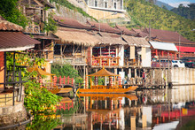 Beautiful Scenery During Sunrise With The Water Reflection Of The Chinese Village At The Lee Wine Ruk Thai Lake, Mae Hong Son Off Thailand.