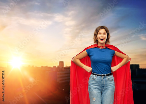 Cuadros en Lienzo  women's power and people concept - happy woman in red superhero cape over sunset