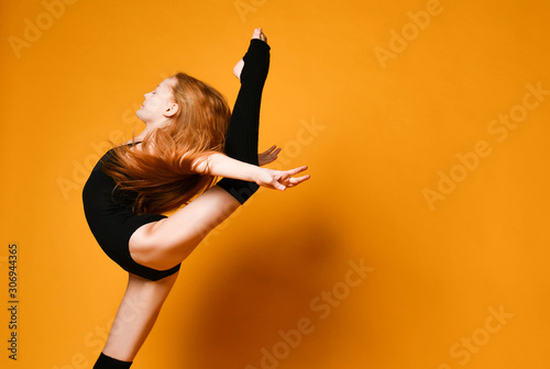 Young sport woman gymnastics doing jumping fitness exercise at sport gym jump on Canvas Print