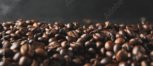 Tuinposter Cafe Coffee beans against black background, close up and space for text