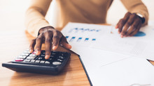 African American Accountant Calculating Budget Of The Company