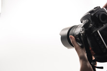 Cropped View Of Photographer Working With Digital Camera Isolated On White