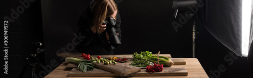 Fototapeta professional photographer making food composition for commercial photography and taking photo on digital camera , panoramic shot obraz