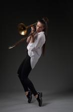 Girl Dancing With Trombone