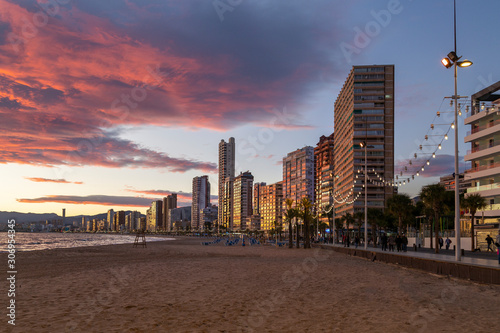 Editorial BENIDORM, SPAIN - NOVEMBER 24, 2019: Sunset over the towering hotels and apartments on Levante beach in Benidorm, Spain