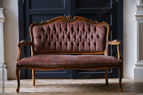 An old antique sofa, with holes in the fabric. Canvas Print