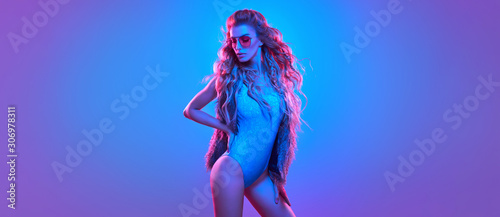 Fotografie, Obraz Fashionable glamour beautiful woman with Trendy wavy neon light hairstyle