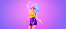 Adorable Fashion Woman In Party Outfit Dance, Trendy Neon Light Hairstyle. Night Club Music Vibes, Gel Filter. Excited Shapely Beautiful Girl Dancing. Pop Art Fashionable Creative Neon Color.