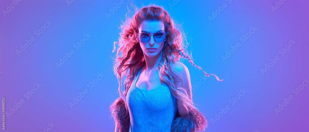 High Fashion. Party disco girl with pink neon hairstyle dance. Sensual woman in Colorful uv Light. Vibrant fashionable creative Style. Night Club music vibes, dancing. gel filter light, neon portrait <span>plik: #306981752 | autor: evgenij918</span>