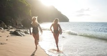 Footage Of Two Surf Girls Runn...