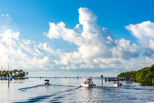 Boats Heading Out Into Biscayne Bay, Florida From Matheson Hammock Park Marina On A Beautiful Bright Summer Day