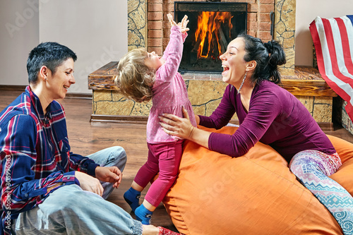 Same sex couple and little daughter are playing. Fototapete
