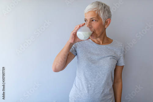 Obraz na plátně Senior Woman Holding Glass Of Milk At Home