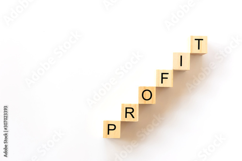 Fototapeta Business concept., Stairs of wooden cubes with PROFIT word on white background with copy space for text. obraz na płótnie