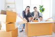 asian family packing and unpacking paper box together, they will decorating and cleaning home, they feeling happy in family time, they move to a new residence
