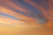 canvas print picture - Brilliant orange sunset and sunrise beautiful over orange clouds with bright orange sun on a cool spring morning.