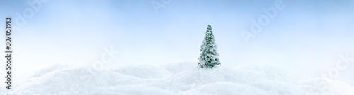 fototapeta na drzwi i meble Wintery landscape background with single tree on glistening white snow drifts