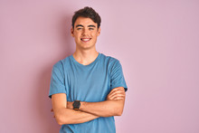 Teenager Boy Wearing Casual T-shirt Standing Over Blue Isolated Background Happy Face Smiling With Crossed Arms Looking At The Camera. Positive Person.