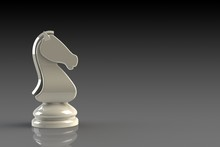 White Knight Chess Piece On Gr...
