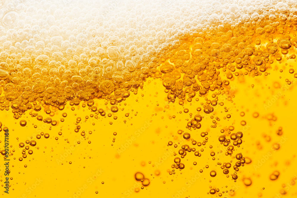 Fototapeta Beer background with bubble froth texture foam pouring alcohol soda in glass happy celebration party holiday new year concept object design