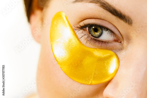 Obraz na plátne Woman with gold patches under eyes