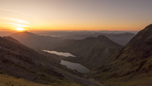 Sunrise Through A Snowdonia Mountain Valley In Wales, UK