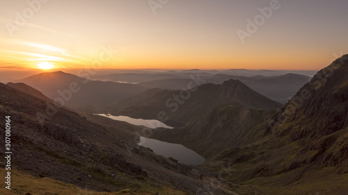 Canvas Print Sunrise through a Snowdonia mountain valley in Wales, UK