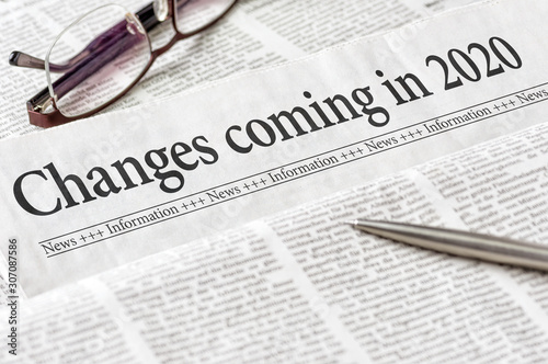 A newspaper with the headline Changes coming in 2020 Fototapete
