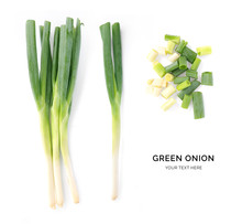 Creative Layout Made Of Green Onion. Flat Lay. Food Concept. Green Onion On White Background.