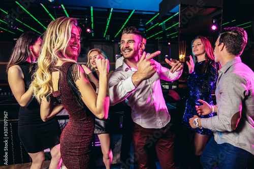 Young people dancing in night club - 307097967