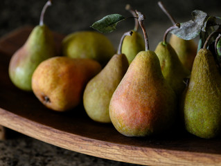 Comice pears on a wooden platter