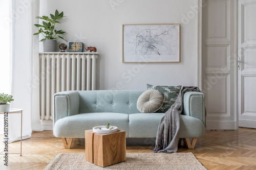Obraz Stylish scandinavian living room interior with design mint sofa, furnitures, mock up poster map, plants, and elegant personal accessories. Home decor. Interior design. Template. Ready to use.  - fototapety do salonu