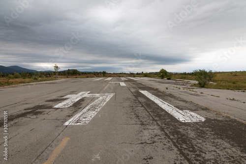 Runway abandoned military airfield Zeljava in Croatia Canvas Print