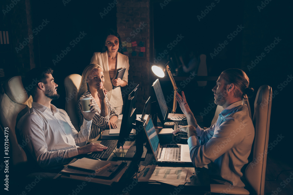 Fototapeta Profile side view of nice attractive cheerful guys coworkers ceo boss chief partners leaders experts preparing finance report at night at work place station dark room indoors