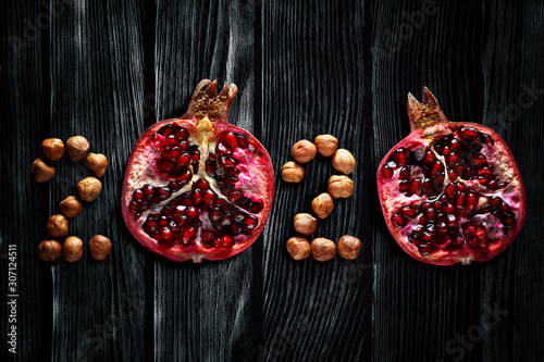 Healthy holidays food and diet. Number 2020 made from fruits and nuts. New Year and Christmas 2020 decisions about a healthy lifestyle.