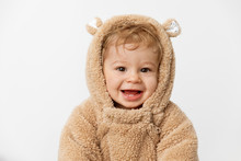 Cute Smiling Baby Wearing Hooded Bear Suit