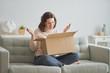 woman is holding cardboard box