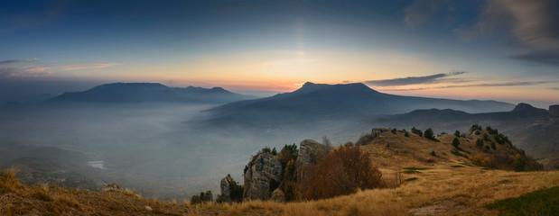 Sun hidden behind mountains. Scenic view