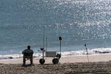 Surf Fisherman Waiting For A B...