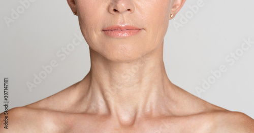 Canvas Print Skin care. Half face portrait of mature woman