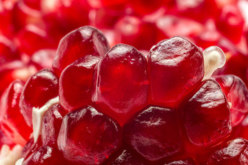 Macro view of ripe cut pomegranate fruit. Food background.