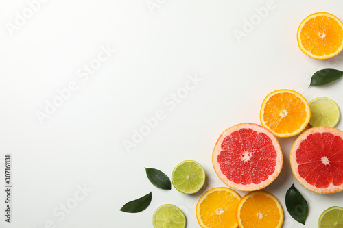 Fotografía  Flat lay with exotic fruits on white background, space for text