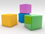 Four colored toy cubes on a white background