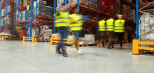 Warehouse Workers Walking In W...