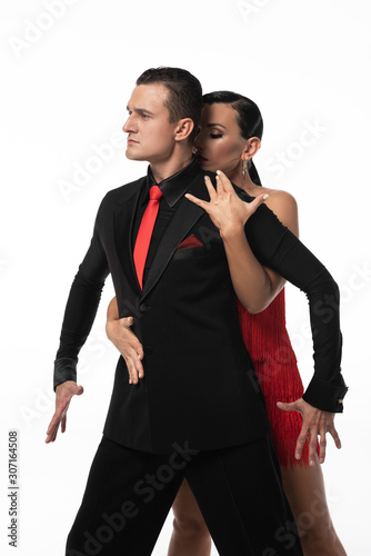 Photo attractive dancer hugging partner from back while performing tango isolated on w