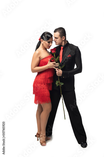 expressive, elegant dancer gifting red rose to attractive, sensual partner on white background