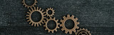top view of retro metal gears on dark wooden background, panoramic shot